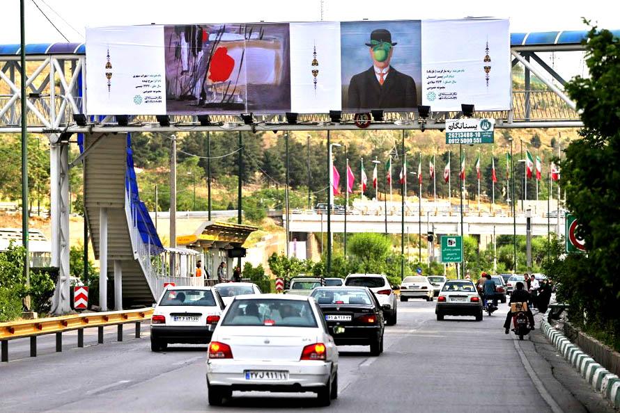 Ο εφαρμοσμένος σουρρεαλισμός στην καθημερινότητα των Ιρανών: Μαγκρίτ και αγιατολάδες. Photo credit: AP / Ebrahim Noroozi