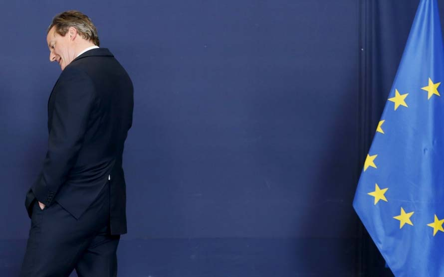 Britain's PM Cameron arrives to pose for a family photo during an EU leaders summit in Brussels