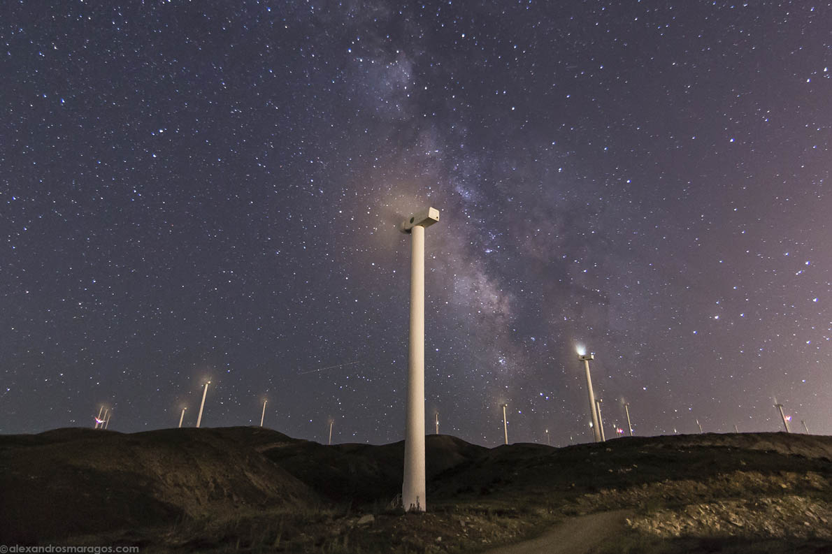 The Milky Way rises over Greece's largest Wind Park at the top of Panachaiko Mountain (1600m), in Patra, Achaia, Greece.