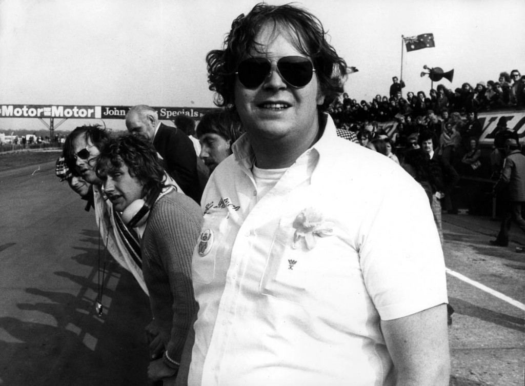 Lord Hesketh, head of Hesketh Racing, standing beside the track at Silverstone, at the very moment when he realised that his driver, james Hunt, had won the international Trophy race (April 1974); it was the team's first great international success, and established Lord Hesketh among the leading racing personalities. 25436-24 Special Price Applies - consult Camera Press or it's local agent