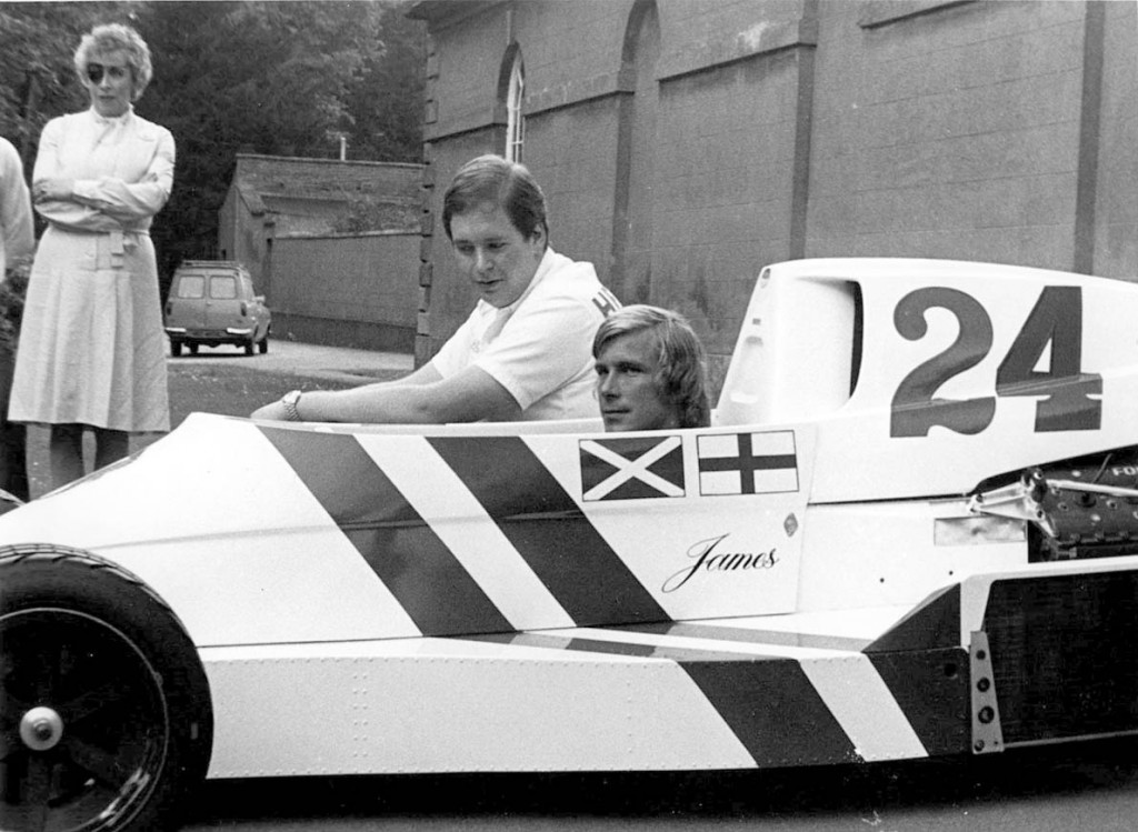 Mandatory Credit: Photo By CHARLES KNIGHT / Rex Features JAMES HUNT WITH ALEXANDER HESKETH, WITH HESKETH MOTHER IN BACKGROUND. 1975 James Hunt motor racing driver sportsman formula one driver sitting in racing car with Alexander Hesketh