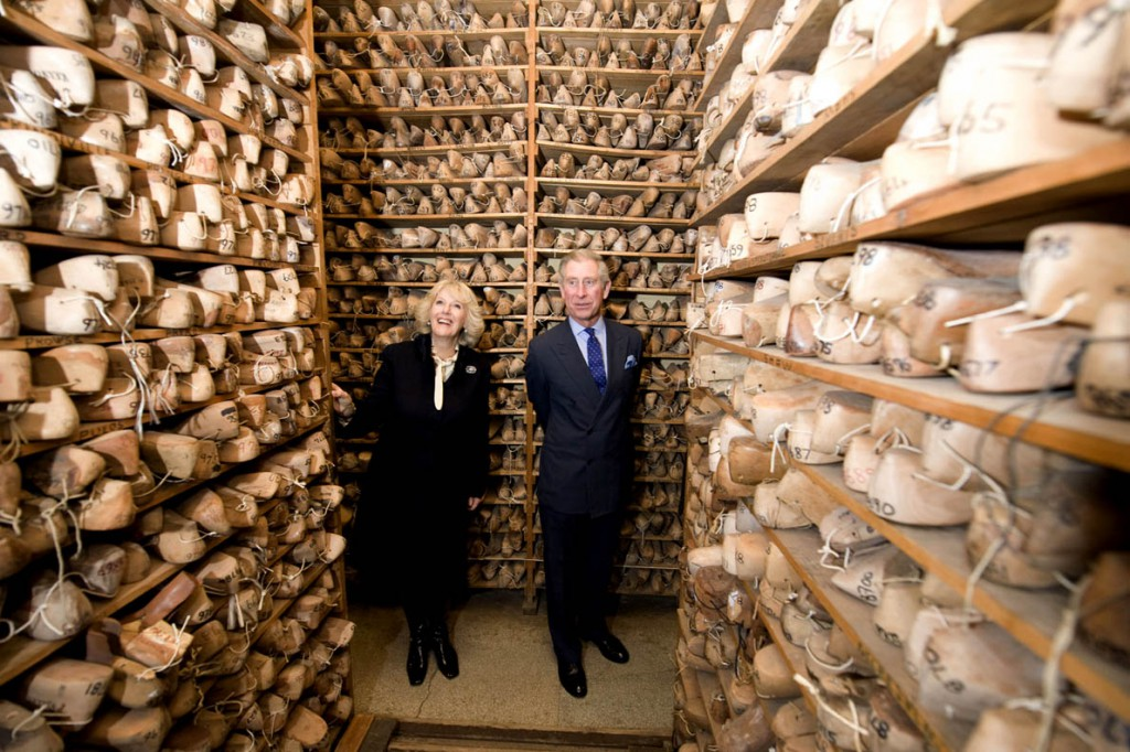 THE PRINCE OF WALES AND THE DUCHESS OF CORNWALL VISITING THREE BUSINESS IN LONDON THAT HOLD THE PRINCE OF WALES'S ROYAL WARRANT . THE PRINCE AND DUCHESS VISITING J LOBB SHOEMAKER AND LOOKING A THE STORE ROOM FOR THE CUSTOMERS LASTS . ROYAL ROTA PICTURE BY PAUL EDWARDS . SEE PA STORY .