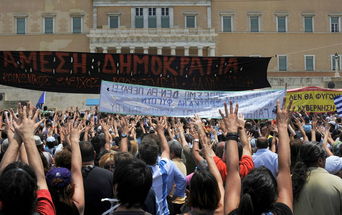 1280px-20110629_Moutza_demonstrations_Greek_parliament_Athens_Greece