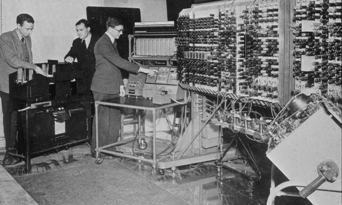 The pilot ACE is one of Britain's earliest stored program computers and the oldest complete general purpose electronic computer in Britain. Designed and built at the National Physical Laboratory, Middlesex in 1949-1950, it was based on plans for a larger computer (the ACE) designed by mathematician Alan Turing (1912-1954) at NPL between 1945 and 1947. Turing had worked on the Colossus computer used in codebreaking at Bletchley Park during World War II. The pilot ACE was estimated to have cost £50,000 to design and build, but by 1954 had earned over £240,000 from advanced scientific and engineering work in various fields. Seen here (left to right) are G G Allway, E A Newman and L H Wilkinson.