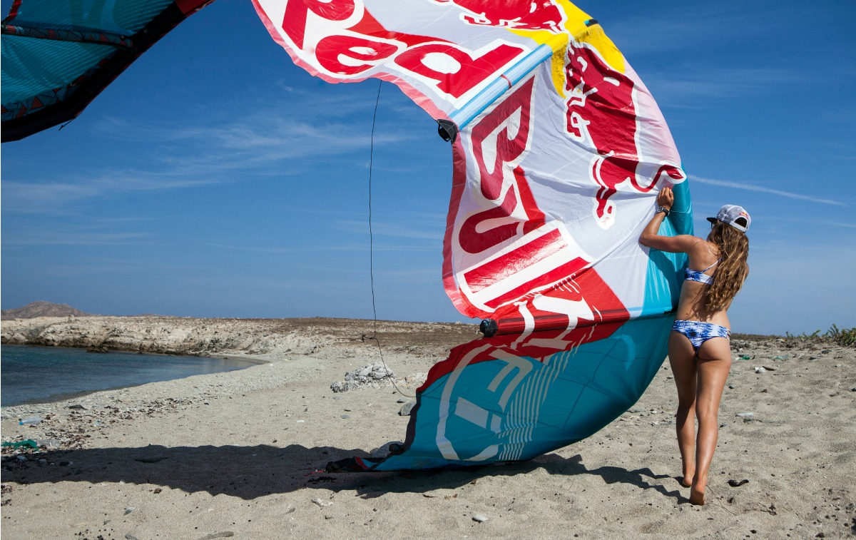 Kitesurf Clinic with Gisela Pulido in Mykonos island Greece. Gisela Pulido getting ready to go kitesurfing.