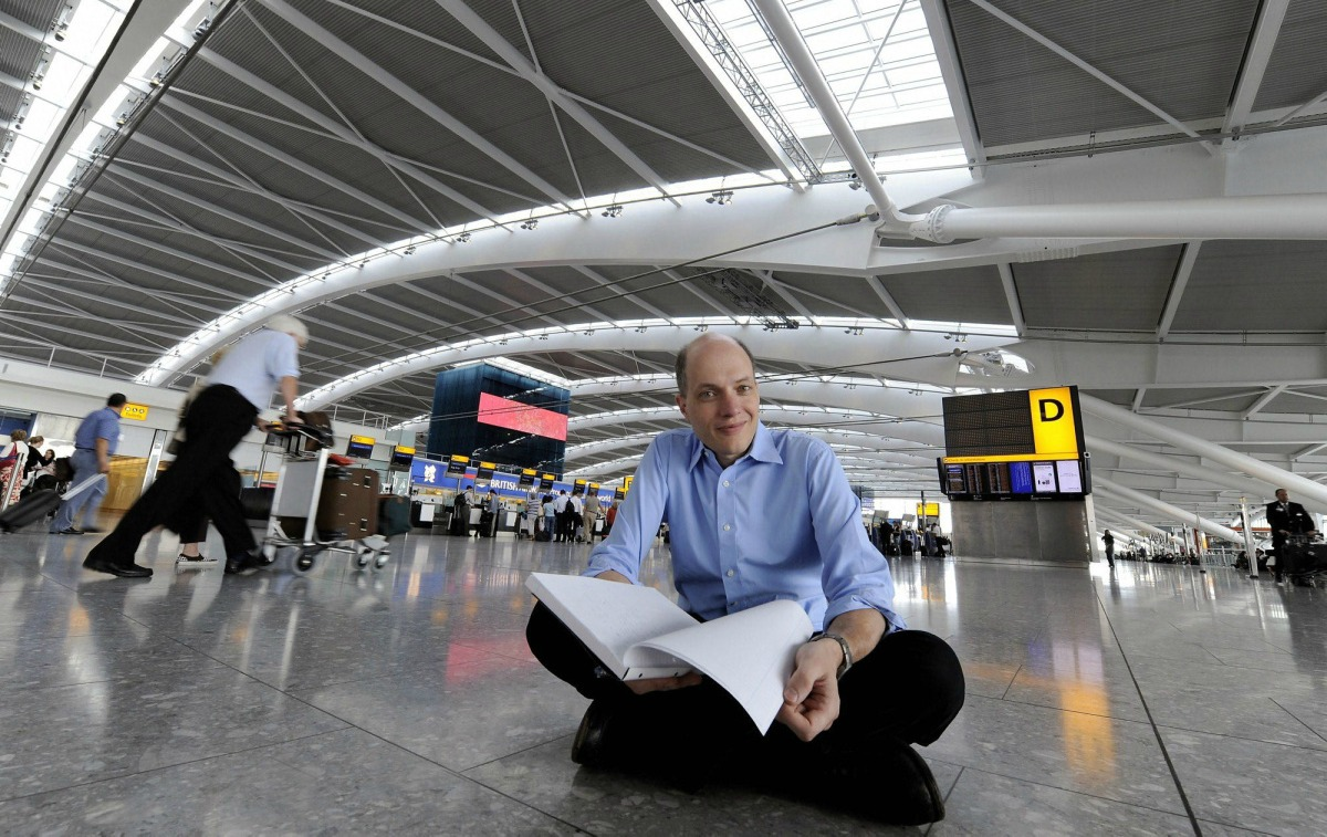UNITED KINGDOM OUT NO SALES NO INTERNET NO MAGS In this image taken Tuesday Aug. 18, 2009 author Alain de Botton, poses for the camera at London Heathrow Airport's Terminal 5. De Botton best known for works of philosophy has become the first writer in residence at Heathrow Airport and is spending a week inside Heathrow's Terminal 5. (AP Photo) ** UNITED KINGDOM OUT NO SALES NO INTERNET NO MAGS **ÿ