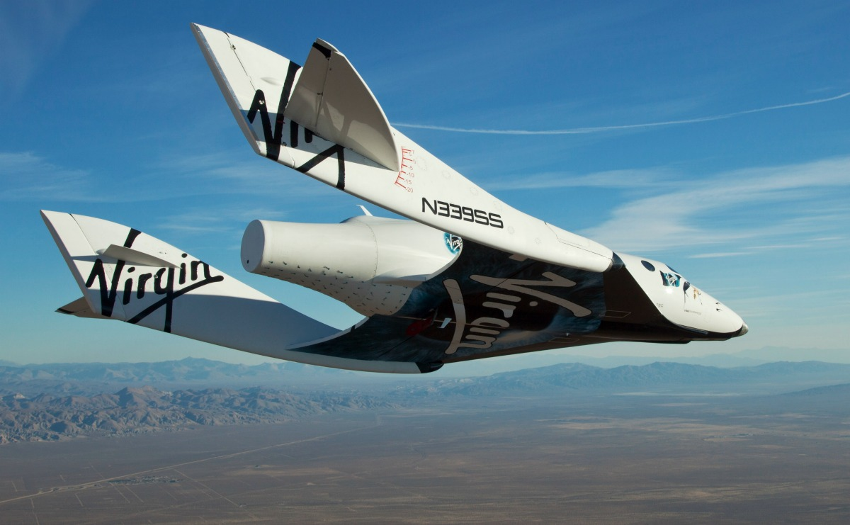 "the Virgin Galactic SpaceShip2 (VSS Enterprise) glides toward earth on its first test flight after release from the mothership, ""WhiteKnight2"" (VMS Eve) over the Mojave, Ca. area early Sunday October 10. The craft was piloted by engineer and test pilot Pete Siebold from Scaled Composites."