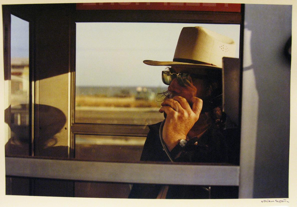 Los Alamos Portfolio-California, 1974_Walter Hopps in phone booth © Eggleston Artistic Trust. Courtesy of The Wilson Centre for Photography